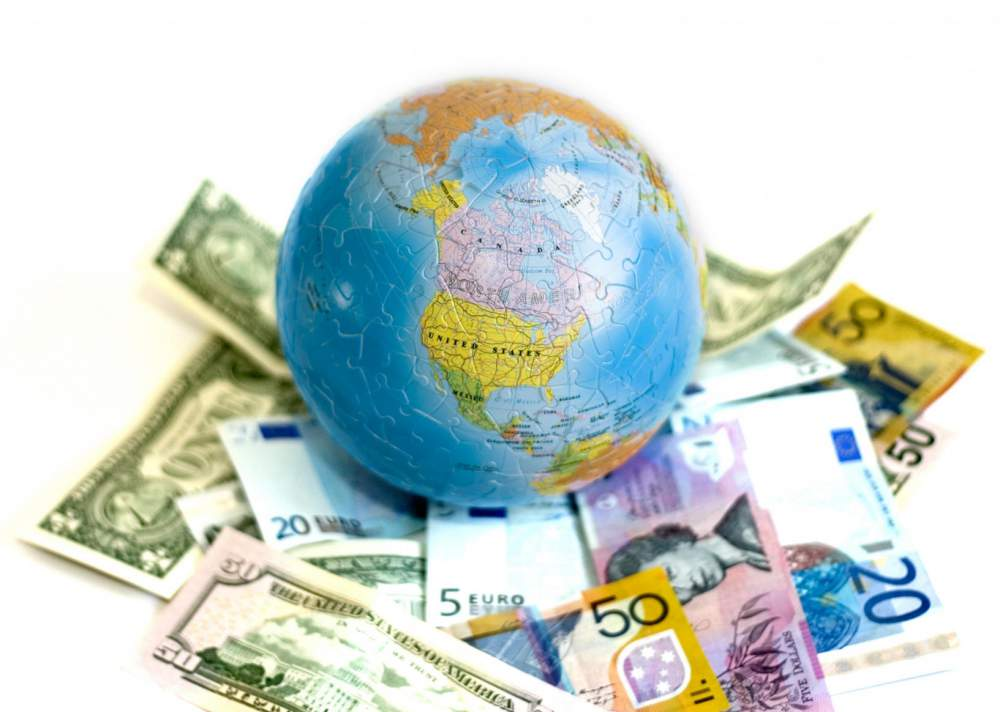 Three most important factors in determining exchange rates